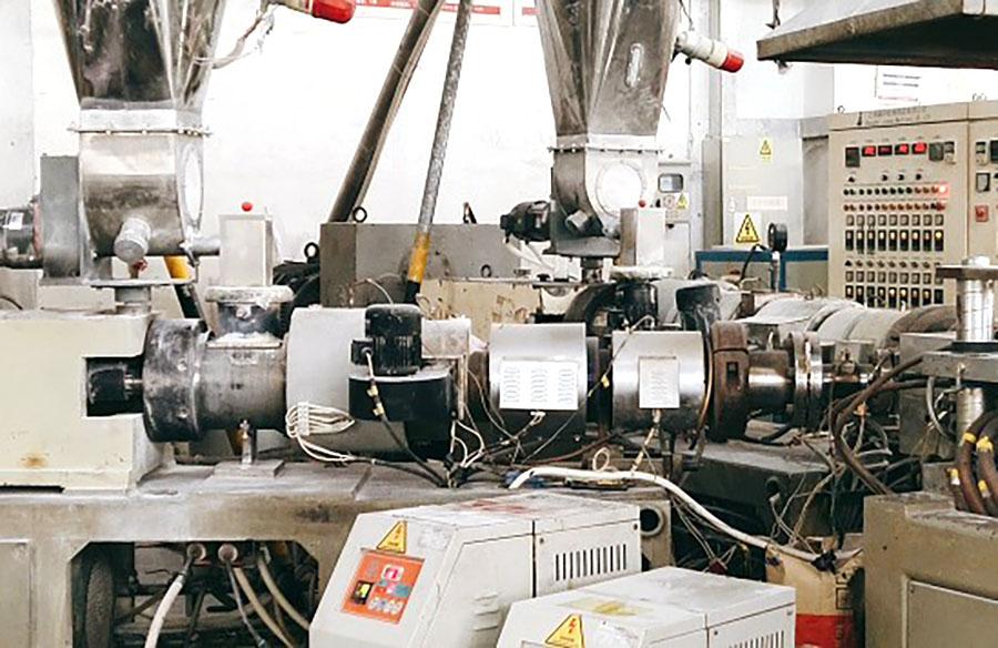Three-layer coextrusion foam board production line